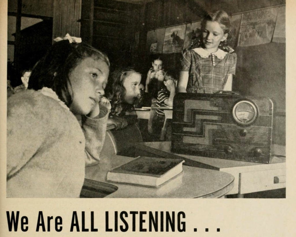"photo of girls listening to a radio with the text: ""We Are ALL LISTENING""; image source: https://archive.org/details/seehear194850journaloneaucrich/page/n286/mode/2up"
